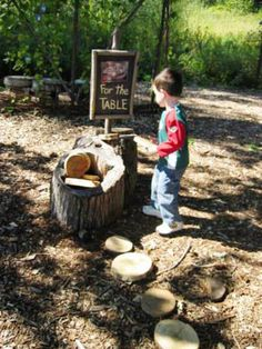 """INCLUDE LOOSE PARTS  Your child will, of course, make their own additions to the natural playscape. """"Tree cookies""""—sanded slices of logs—are a natural playground classic and easy to make on your own. They can be stacked and counted, laid out as paths, or serve as plates for a make-believe dinner."""