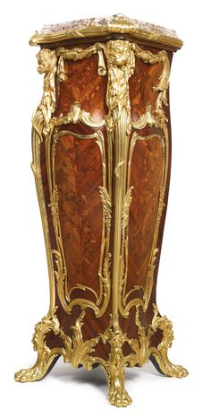 A gilt bronze mounted kingwood, satiné, fruitwood and end-cut floral marquetry pedestal Paris, late 19th/early 20th century surmounted by a breche de Benou jaune marble top height 52 in. 132 cm