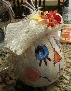 Was a broken gourd so I covered the top with a hat.   Scarecrow gourd