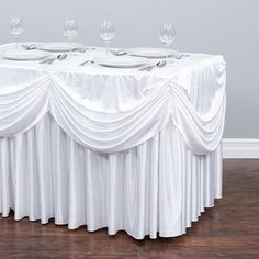 Shop for rectangular tablecovers at LinenTablecloth. Rather than buying a table skirt, skirt clips, tablecloth, and draping, our 4 ft. Drape Chiffon Tablecloth/Pleated Skirt White is a simple solution that replaces it all. Wedding Table Linens, Wedding Reception Decorations, Tutu Table, Sequin Tablecloth, Tablecloths, Inexpensive Wedding Venues, Budget Wedding, Custom Drapes, Table Covers