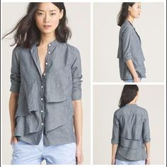 "J. CREW Chambray Pararuffle Shirt Denim shirt with a feminine twist. Lovely waves of ruffles don this collarless number. Style from several years back & is no longer available. Measures (relaxed) 17""pit-to-pit x 26"" length. Retailed for $108. J. Crew Tops"