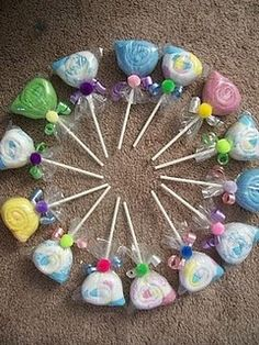 Baby Shower --lolly pops made from baby wash cloths!