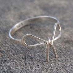 Silver Bow Ring - A stunning delicate Silver Bow Ring featuring a handmade polished bow to top it off - the perfect jewellery accessory for this season! #Otisjaxon #Jewellery