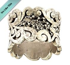 """""""Lois Hill swirled cuff ring is a must-have in your fashion jewelry collection. This fantastic cuff ring is truly unique. Both granulated sterling silver spheres arranged in an intricate swirl design and carved sterling silver swirls embellish the full length around. Chic and timeless, the ring will go with any ensemble. Available in size 7 or 8.""""    $168.00USD"""