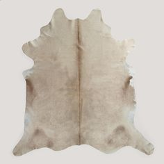 Hand-selected Brazilian cowhides with soft, neutral hues. Like all rugs crafted from natural hides, each is a unique. - Brands and other markings add character to the hides, each one unique. - Natural
