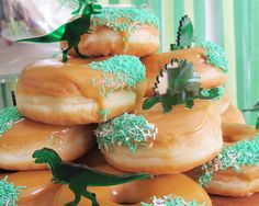 the creative muster | dinosaur party cake toppers on donuts