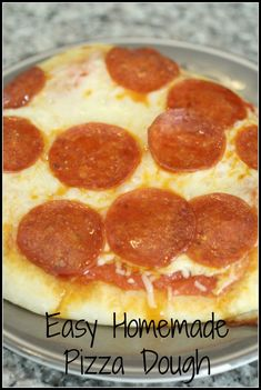 An easy homemade pizza dough recipe that can last in the refrigerator for up to two weeks! Great to make individual pizzas for pizza night!