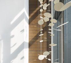 POINTE-NORD | Montreal | Architecture | Interior Design | Evolo 2 | Residential | Artwork | Art | Ceramic | Light | Wood Montreal Architecture, Interior Architecture, Ceramic Light, Condominium, Interiores Design, Wind Chimes, Ceramics, Wood, Outdoor Decor