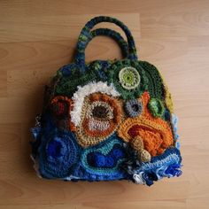 pic crochet bags   Here's the bag from different angles. The raised pebbles were stuffed ...