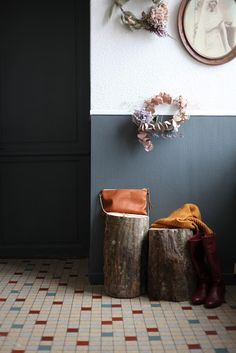 love this entry way idea from ledansla, tree stumps as tables, confetti tiles and dried flower wreaths Half Painted Walls, Wall Design, House Design, Interior Decorating, Interior Design, Grey Walls, Floor Rugs, Tile Floor, House Rooms