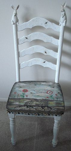 An altered art chair. This is a found chair that I altered with collage work stencils and found objects.