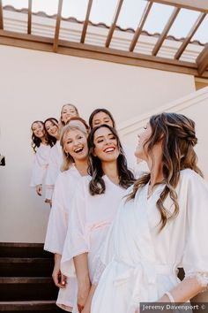 Bridal party photo on different levels of staircase, fun photo ideas