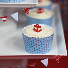 Sailor theme party with anchor cupcakes and flag banner