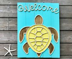 This beachy piece of art is perfect way to welcome your guests into your beach house! Each sign is hand cut, hand sanded and hand painted. Each sign is made from reclaimed wood so no two signs will be exactly alike due to variations in the wood. All signs have cable wire on the back