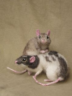 These aren't real rats, though they might look it. They're needle-felted creatures handmade by Hannah Stiles. Amazing work!