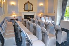 Bagden Hall - Blue Room - Lycra chair covers with blue and dark silver sash.  www.uniqueweddingflowers.co.uk