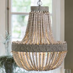 You can use the modern wood chandelier above the dining table or in a living room with a high ceiling. The chandelier has a . read on Chandelier Art, Chandelier Bedroom, White Chandelier, Beaded Chandelier, Bedroom Ceiling, Chandeliers, Ceiling Rose, Ceiling Lights, Farmhouse Chandelier