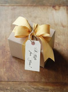 Brown box, striped ribbon in cornflower, simple tag.