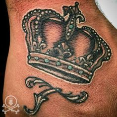 Lovely queen crown and initial hand tattoo by Jose Bolorin.  #12ozstudios #team12oz #tattoo #tattoos #tattooart #tattooartist #handtattoos #queen #crown #tattoosformen #tattoosforwomen