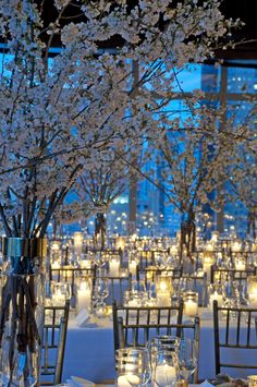 Winter wonderland delight. Flowering branches and LOTS of candlelight make for a WOW moment at this event David Stark Design did for New Yorkers for Children.