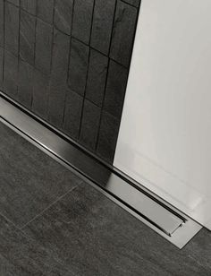 Wet room ideas - Achieve a stunning, clean finish by using the Highline Panel finish. #wetroomideas #wetroomdesign #unidrain #inspirational