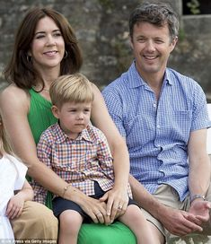 My turn: Prince Vincent also got his chance to sit in his Australian-born mother's arms...