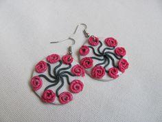 Swirling flowers polymer clay dangle earrings. $12.00, via Etsy.