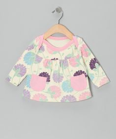 Pretty pockets and slight gathering give this soft cotton top a playful touch. A handy lap neck makes changing a cinch and a loop sewn into the side is the perfect place to connect a pacifier. 100% cottonMachine wash; tumble dryImported