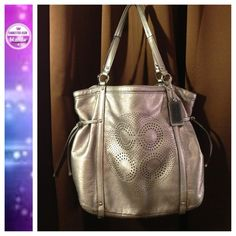 HOST PICK Coach large Op Art tote This fantastic tote is soft supple leather with the silver metallic finish. Laser punched Op Art design with side drawstrings and a full pocket on the back. Satin lavender interior features multiple compartments (a few small ink spots inside). Some wear and fading of the silver metallic finish in spots on the back and underside of the handles. Price reflects wear. This bag is big enough for iPads, small tablets, and everything else! I really enjoyed this…