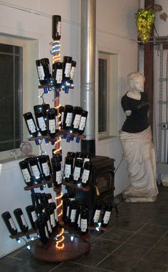 Wine bottle tree rack. Can be broken down and easily stored. Made from recycled oak wine barrel staves.