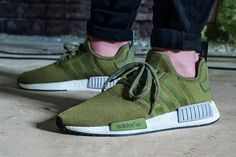 """adidas has unveiled yet another colorway of the enormously popular NMD R1 sneaker: a luscious """"Olive"""" edition only available for the European market."""