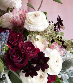 ranunculus, Black Beauty sweetheart rose, protea, chocolate cosmos, lilac, dusty miller, lavender, sumac.  http://www.designsponge.com