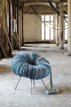 This is kind of amazing: DIY chair with recycled upholstery fabric, inner tube + under-frame