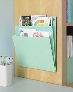 Martha Stewart suggests using pocket folders to keep clutter and important documents in a special place. The hanging folders also come in an elegant, textured finish.