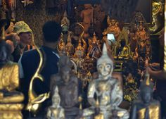 Shop selling statues of Buddha and outher Buddhist trinkets. Exploring the labyrinth of JJ Market in Bangkok, Thailand. Chatuchak Weekend Market. For full blog on JJ Market Bangkok check our blog http://live-less-ordinary.com/southeast-asia-travel/jj-market-bangkok-chatuchak-weekend