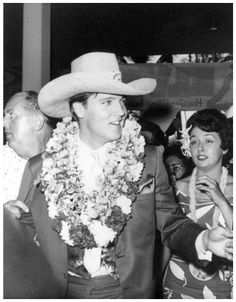 Elvis arrives in Hawaii for his 1961 benefit concert for the building of the USS…