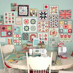 Super cute wall of mini quilts!