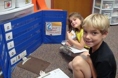 In a Literacy Center, students can sort pictures with short vowels on a pocket chart.