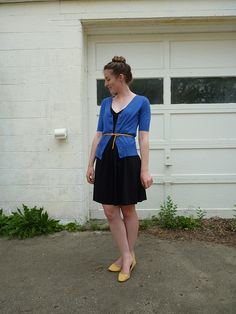 Black Dress, Blue (short sleeved!) Cardigan, Yellow Belt and Flats----- OR with sequined black skirt and a gray tank maybe longer in length cardigan