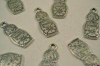 Babushka pendants by Sysimetsä Design