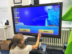 """Jervoise School enjoys its new 55"""" touchscreen touch while using Skoolbo app , free 3D literacy and numeracy games for 4-12 yr olds."""
