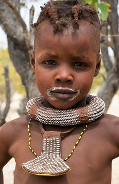 Africa | A young Himba girl photographed after drinking milk.  Opuwo, Kunene, Namibia | ©Georges Courreges