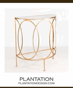 Anthony Console Table  Gold leafed console with antique mirror top and beautiful intersecting oval frame detail. Silver leaf finish is available by special order (2 week lead time).