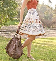 This embroidered tablecloth skirt reminds creator Erika Schacht of her grandmother's collection of embroidered linens and inspires her to create wearable art. See how she made it in Altered Couture Summer 2015!