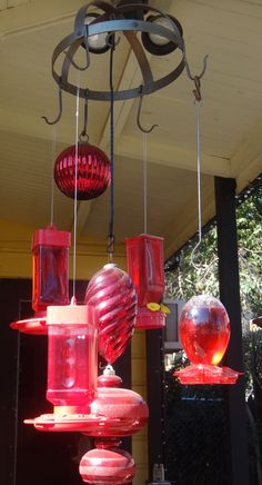 Pot Rack used as Multi-Humming Bird Feeder-Hangar...Added some huge red Christmas ornaments found at a flea market...Too cute...8-10 Humming Birds a day. :~)