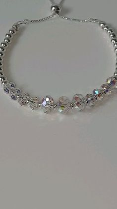 """Mavey Shimmer Bracelet """"Aurora"""" A stunning sterling silver adjustable bracelet featuring beautiful shimmering Swarovski® Crystals in colour: Clear AB (Aurora Borealis). This bracelet will fit wrists inches to 8 inches Bridal Jewelry, Diy Jewelry, Antique Jewelry, Jewelery, Vintage Jewelry, Handmade Jewelry, Jewelry Necklaces, Beaded Necklace, Jewelry Making"""