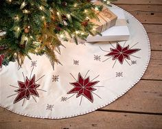 """48"""" North Star Christmas Tree Skirt... Embroidered wine red stars and snowflakes on creme felt... matching Christmas stockings, mantel scarf, table runners, placemats and pillows all in this homespun design. All available @ CountryPorch.com"""