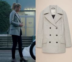 """Betty Cooper (Lili Reinhart) wears this grey button front coat in this episode of Riverdale, """"Chapter Fourteen: A Kiss Before Dying"""". It is the Aritzia Wilfred Free Boyd Coat in Heather Cark Comet"""