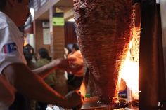 Tacos al pastor—made from marinated pork that's been roasted on a vertical spit—are wildly popular in Mexico City, particularly at night.                  The best taqueros put on a show, slicing off bits of caramelized meat and catching it in one hand (or behind their back!), and then reaching above the meat to slice off a piece of warm, juicy pineapple. According to city folklore, these tacos were invented in the capital. The dish is a direct descendant of shawarma, brought by Lebanese…
