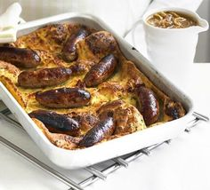 Toad in the hole is a British classic.  Chunky sausages entombed in Yorkshire pudding-style batter and drowned in onion gravy.  Unbelievable.  Recipe link: http://tinyurl.com/d3m4jh